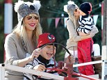 A bear-y nice day at the farm! Real Housewives of Beverly Hills star Brandi Glanville spends day playing with son Jake while wearing a koala hat