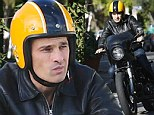 He's a wild one! Olivier Martinez rides chopper in West Hollywood days after car park fender bender