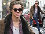 London direction: Harry Styles nipped home from New York in an impressive 24 hours