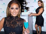 Adrienne Bailon stuns in black lace on a blue carpet as the former Cheetah Girl promotes her new cocktail recipe