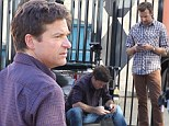 The joys of text! Jason Bateman and co-star Sedeikis are engrossed in their phones during break in filming Horrible Bosses 2