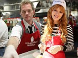 Neil Patrick Harris and Bella Thorne get their hands dirty as they serve up turkey to the homeless at LA Mission