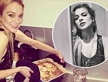 New career? Lindsay Lohan gets ready for Thanksgiving by cooking marshmallow yams but makes time to take a sultry selfie