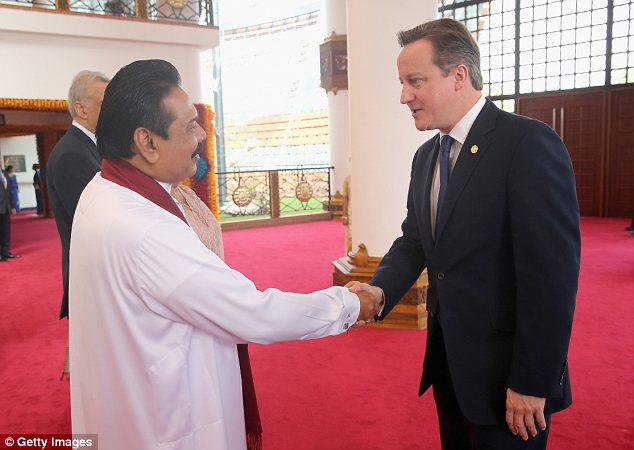 Handshake: President Mahinda Rajapaksa greets David Cameron ahead of the Commonwealth Heads of Government 2013 Opening Ceremony