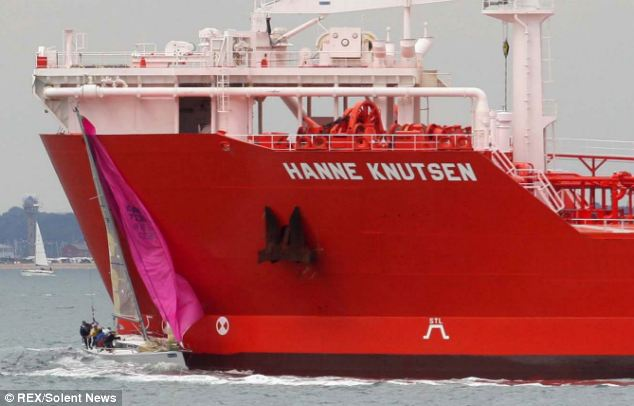 The footage then shows Wilson's yacht hitting the tanker, ripping off the mast and the pink sail