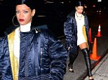 Rihanna adds a sexy twist to her outfit by pairing her white minidress with thigh-high leather stockings