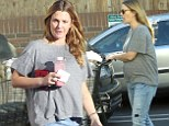 Time to get cooking! Drew Barrymore shows off her bump as she loads up ahead of the Thanksgiving feasting