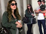Militant duo! Pregnant Megan Fox covers baby bump with army jacket while son Noah rocks camouflage shirt on family outing