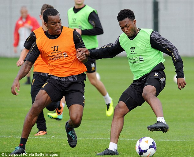 Not again, Andre: Wisdom (left), pictured training with Daniel Sturridge, has been fined for speeding