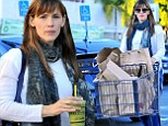 Well, she does have plenty of mouths to feed! Jennifer Garner pushes a trolley load as she stocks up for Thanksgiving and enjoys a healthy juice before 'Turkey Day'
