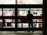 The unknown shopper who declined to give his name waits outside a Kmart store. Instead of waiting for Black Friday, which is typically the year's biggest shopping day, more than a dozen major retailers are opening on Thanksgiving