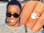 Surely that confirms it! Kelly Rowland flashes huge diamond ring amid engagement rumours