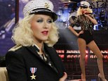 Hello boys: Christina Aguilera slips back into her sexy sailor's uniform from her Candyman days as she performs for the troops on Jay Leno's Thanksgiving special