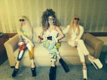 Lady Gaga poses with two of her lifelife GAGADOLLS on Twitter