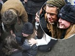 Harry Styles helps an injured fan in new York City on Tuesday
