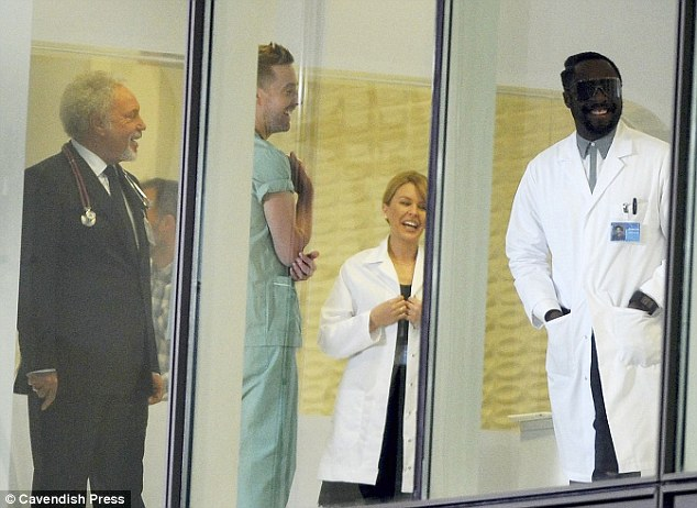 Pint-sized star: Kylie, Tom Jones and Will .I. Am were dressed as doctors during filming