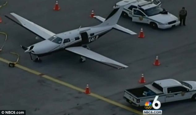 The plane, a Piper PA 46, landed safely at Tamiami Executive Airport and was being guarded by police yesterday