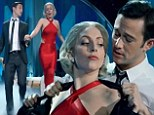 'Baby It's Cold Outside': Lady Gaga wows in slinky red gown as she cosies up to Joseph Gordon-Levitt during Muppets' Holiday Spectacular