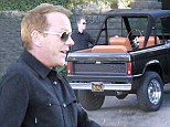 It's Thanksgiving NOT Christmas! Kiefer Sutherland looks pleased as he treats himself to a classic Ford SUV