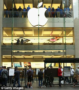 Customers queue up to purchase the iPhone 5 smartphone at the Apple flagship store on George street on September 21, 2012 in Sydney, Australia.