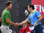 Embrace: Adam Scott (left) leads Rory McIlroy (right) by four shots at the Australian Open
