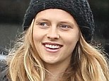 Three for the road! Pregnant Teresa Palmer wears retro floral frock as she takes her family on a rainy day shopping trip in Los Angeles
