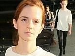 Au naturel: Emma Watson arrives make-up free at London's Heathrow Airport