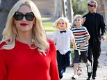 Gwen Stefani dresses her baby bump in a festive red frock to celebrate Thanksgiving with her equally stylish family