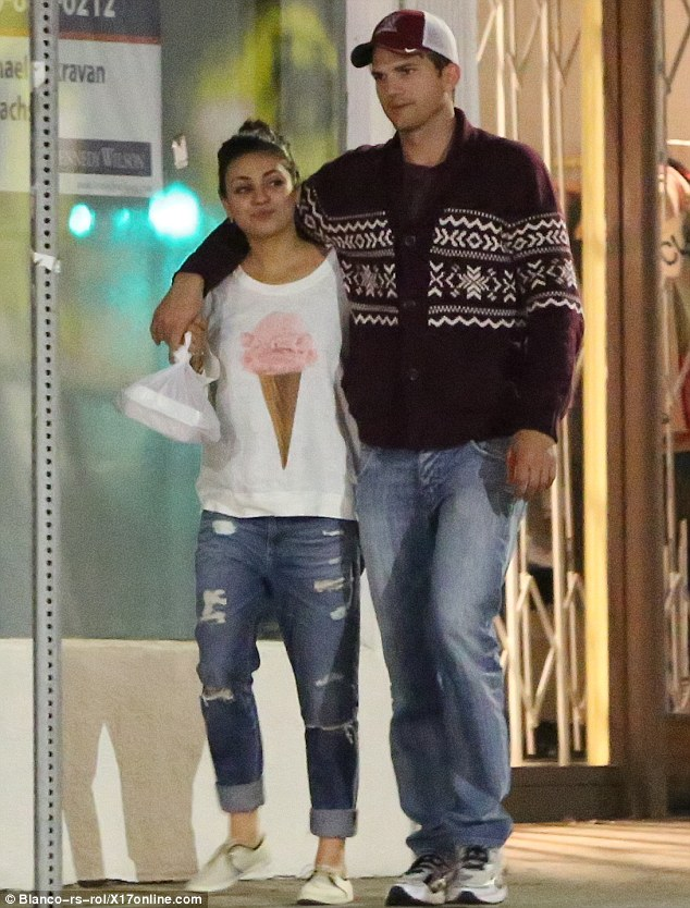 Wedding bells? Sources say Ashton Kutcher, pictured here with Mila Kunis earlier this week, is preparing to propose