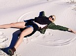 Cheeky beach: Ireland Baldwin asked her fans if she was making an angel in sand or snow on Saturday