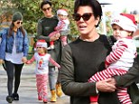 'Tis the season! Kourtney Kardashian, left, dressed her kids Mason and Penelope in elf costumes to see a movie with her mother Kris Jenner, right, and Bruce Jenner (not pictured) to a movie in Calabasas, California on Friday