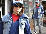 Ellen Page layers up in baggy trousers and denim gilet as she picks up Thanksgiving groceries