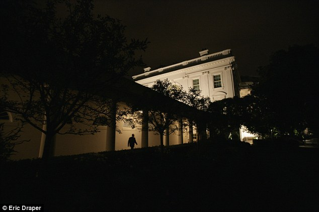 Dark times: President Bush is pictured walking back to the White House after addressing the nation from the West Wing on the fifth year anniversary of the September 11 attacks