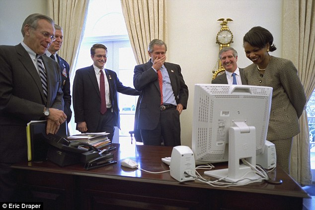 Sense of humor: Mr Bush proves he can laugh at himself as he watches a Saturday Night Live video on an aide's computer in the Outer Oval Office with Secretary of Defense Donald Rumsfeld (left) and National Security Adviser Condoleezza Rice (right)