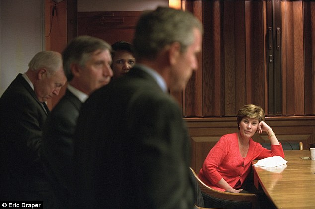 Sad day: First lady Laura Bush listens as her husband discusses the terrorist attacks with advisers on September 11, 2001