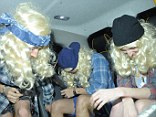 Tickled pink: Harry and his chums couldn't contain their giggles as they headed off in the back of a cab together