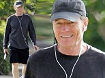 Walking bad! Bryan Cranston gets some exercise with his dog while out in Los Angeles