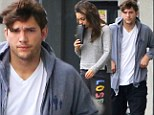 How romantic! Mila Kunis and Ashton Kutcher dress down in baggy tracksuits to get foot massages together