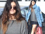 Kylie Jenner braves both the crowds and the rain to go shopping on Black Friday with her friends in a thigh-baring mini skirt