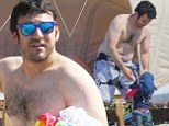 Well, they are the Wonder Years! Fred Savage makes the most of bonding time with his one-year-old son on Hawaii beach