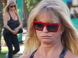 Bah humbug! Goldie Hawn dons quite the scowl after Thanksgiving trip to the gym before heading to son Oliver Hudson's house for the holidays