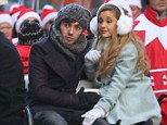 Ariana Grande and Nathan Sykes cosy up on golf cart and whisper to each other during Macy's Parade