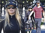 Pump up the volume! Music-loving Fergie shows off her slimline figure on power walk with Josh Duhamel