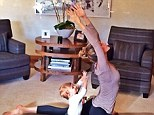 Starting young: Gisele Bundchen practices yoga whilst her adorable baby daughter Vivian imitates her