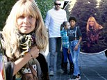 Well, that is certainly a lot of holiday spirit! A makeup-free Heidi Klum and her family pick out six Christmas trees, including a massive 12 foot fur