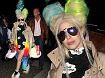 Gaga and her Technicolour Dreamcoat: Singer wears brightly coloured coat to greet fans in Tokyo