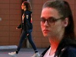 Not feeling very thankful? A glum looking Kristen Stewart grabs some last minute Thanksgiving supplies