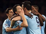Love you all: Nasri blows a kiss after slotting his second and City's third