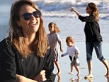 Seeking solace in her family: Jessica Alba enjoys a day at the beach with daughters and husband Cash Warren after tragic death of co-star Paul Walker