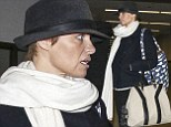 Pamela Anderson shows off a darker hair colour at LAX